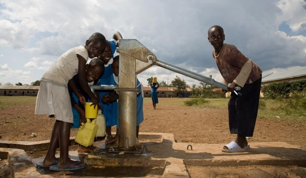 School kids fetching water from community borehole