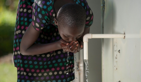 Girl drinking water from SWAP kiosk taps (Karim photography(c)2020)